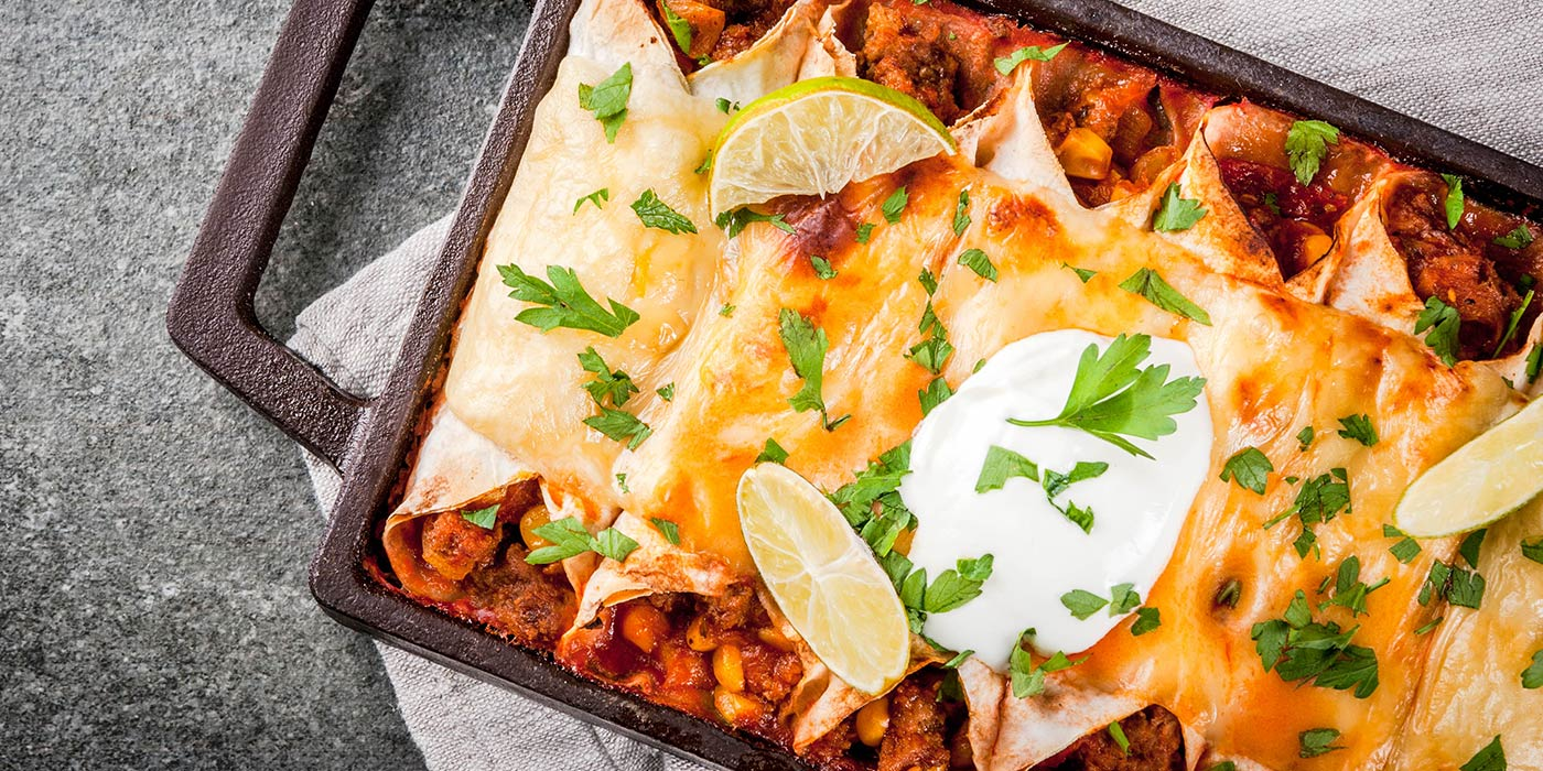 cheesy enchiladas in baking dish