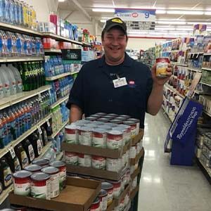 Bakery Manager Jason Gossett with 150 cans of vegetables