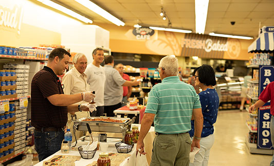 Shoppers at tasting event in grocery store