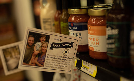 """Pepper relish displayed on shelves with """"made by"""" tag"""