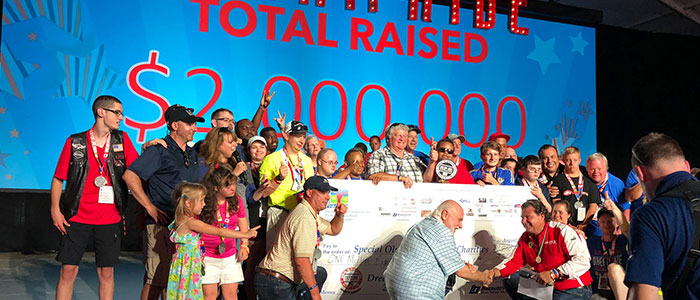 Dream Ride Experience with group of people on stage holding $2 million check