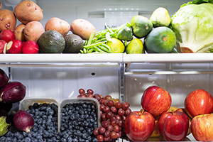 fruits and vegetables piled in fridge