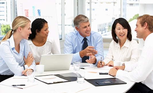 Group of co-workers smiling in meeting