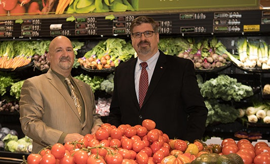men dressed in suits in produce section