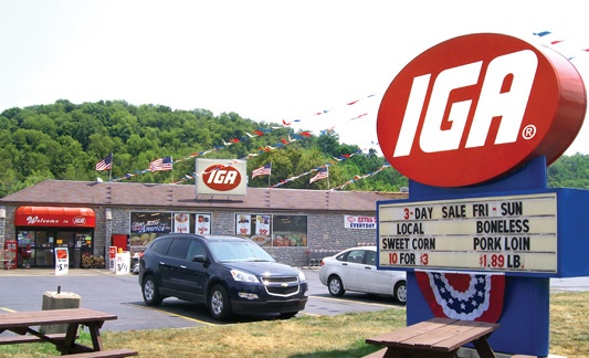 iga storefront with parking lot