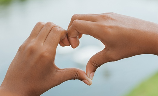 hands making the shape of a heart