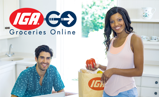 IGA GO Groceries Online logo on an image with a couple in a kitchen smiling