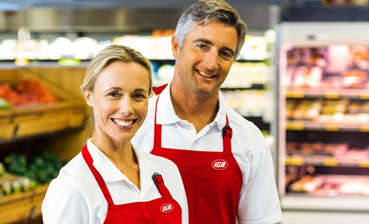 Woman and man IGA employees smiling for camera