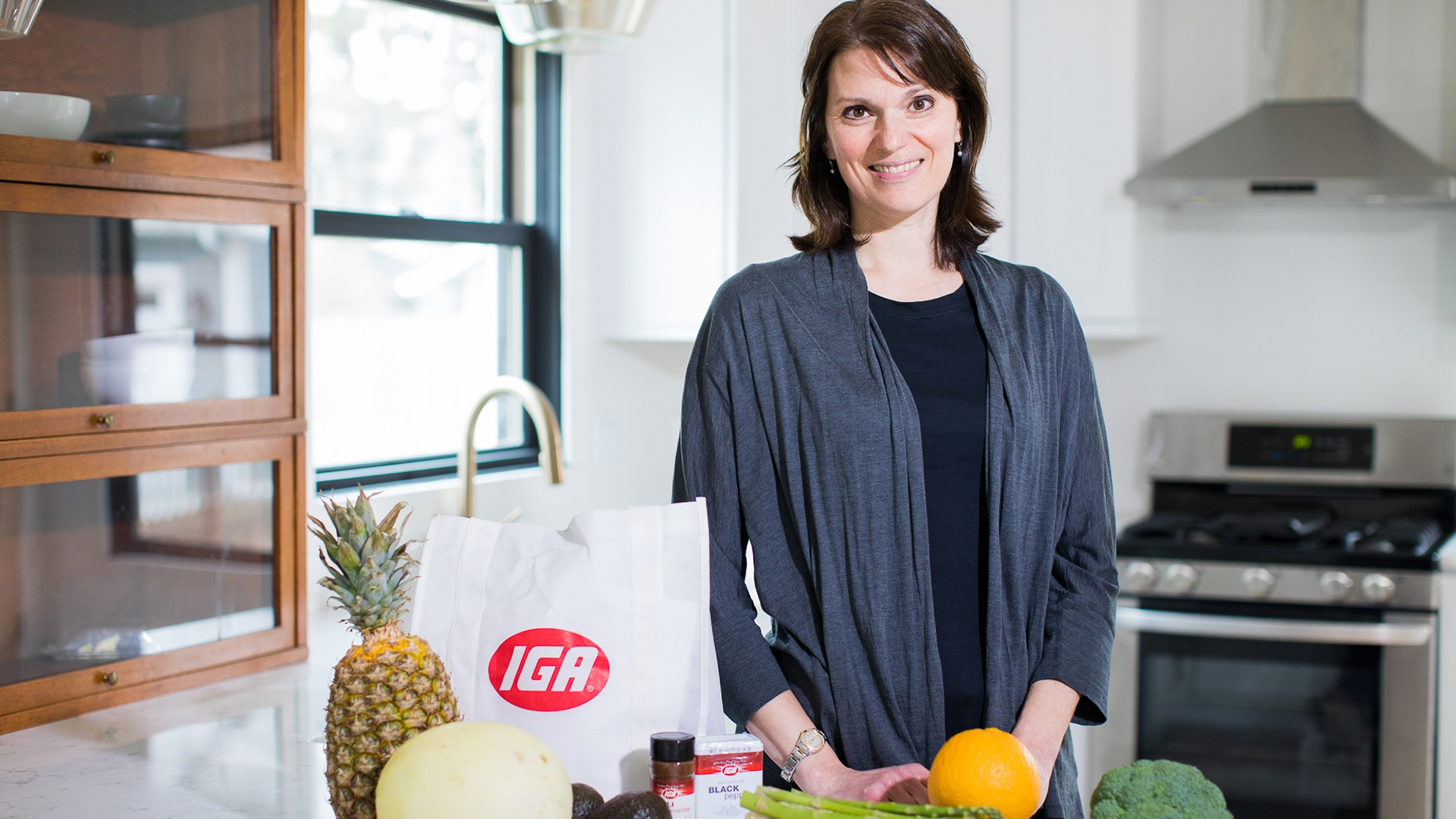 Kim our nutritionist in kitchen with IGA groceries