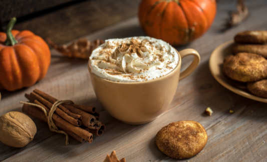 Homemade pumpkin spice latte on a table with fall decor